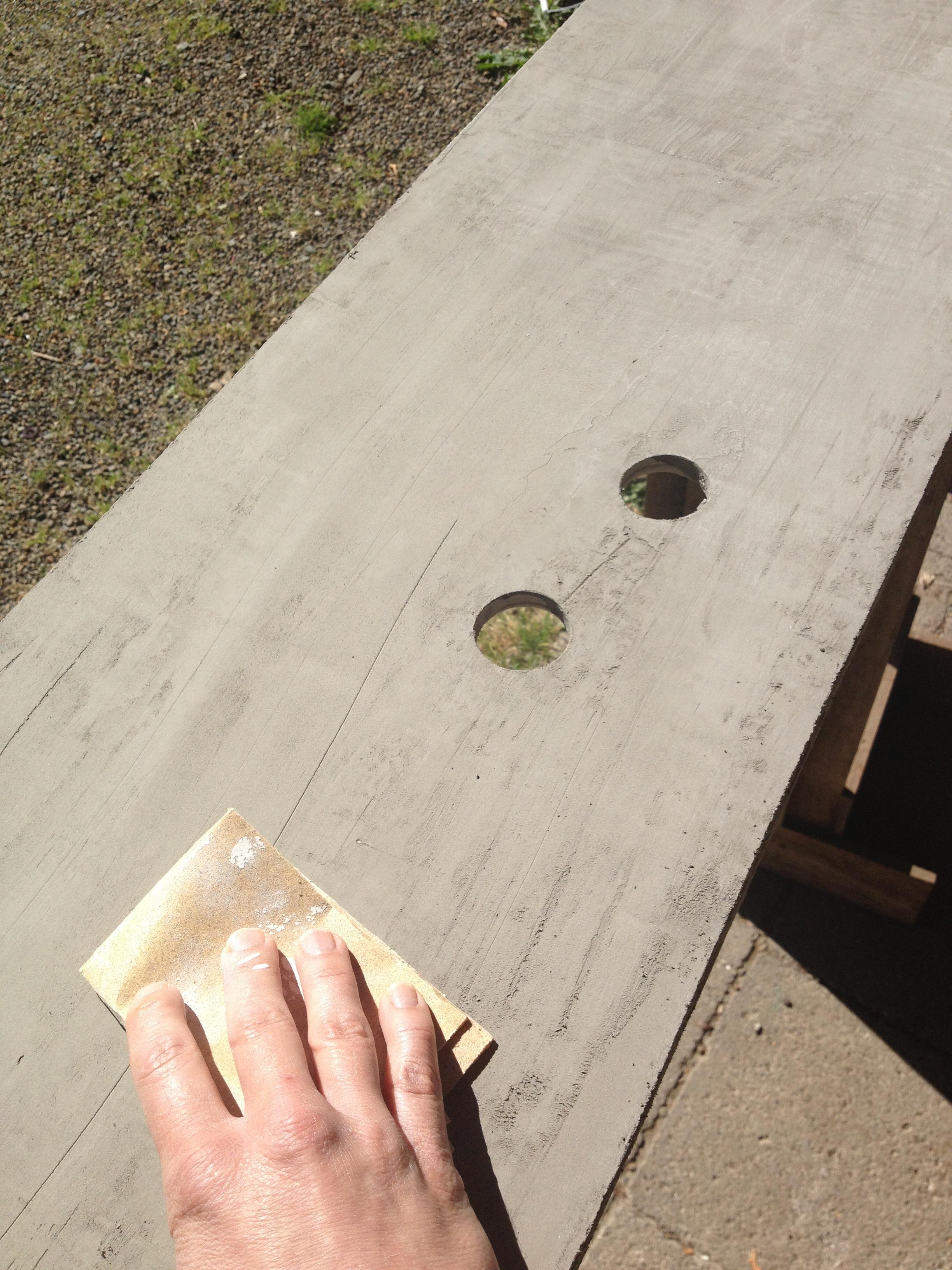 sanding the concrete